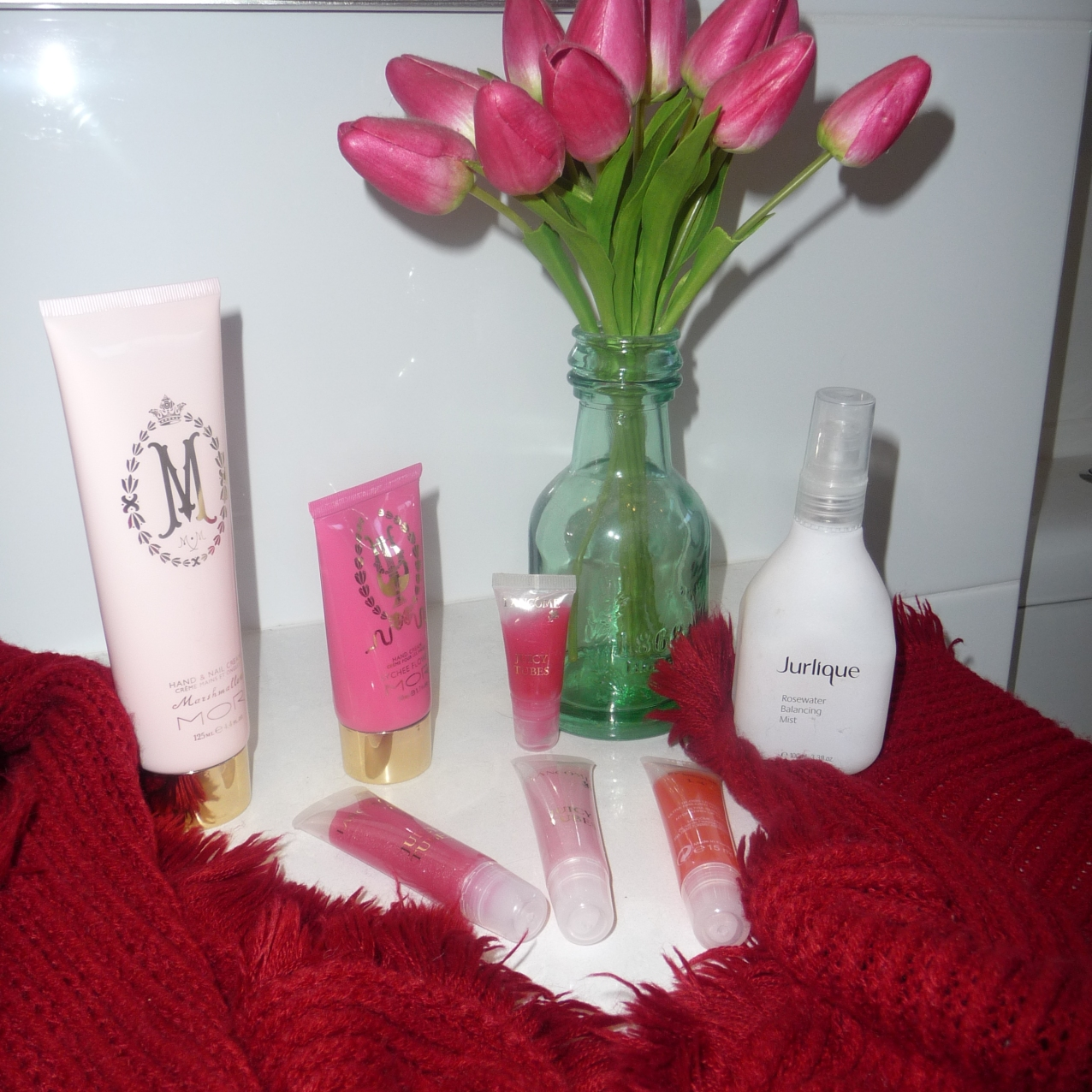 Travel essentials including red pashmina/scarf