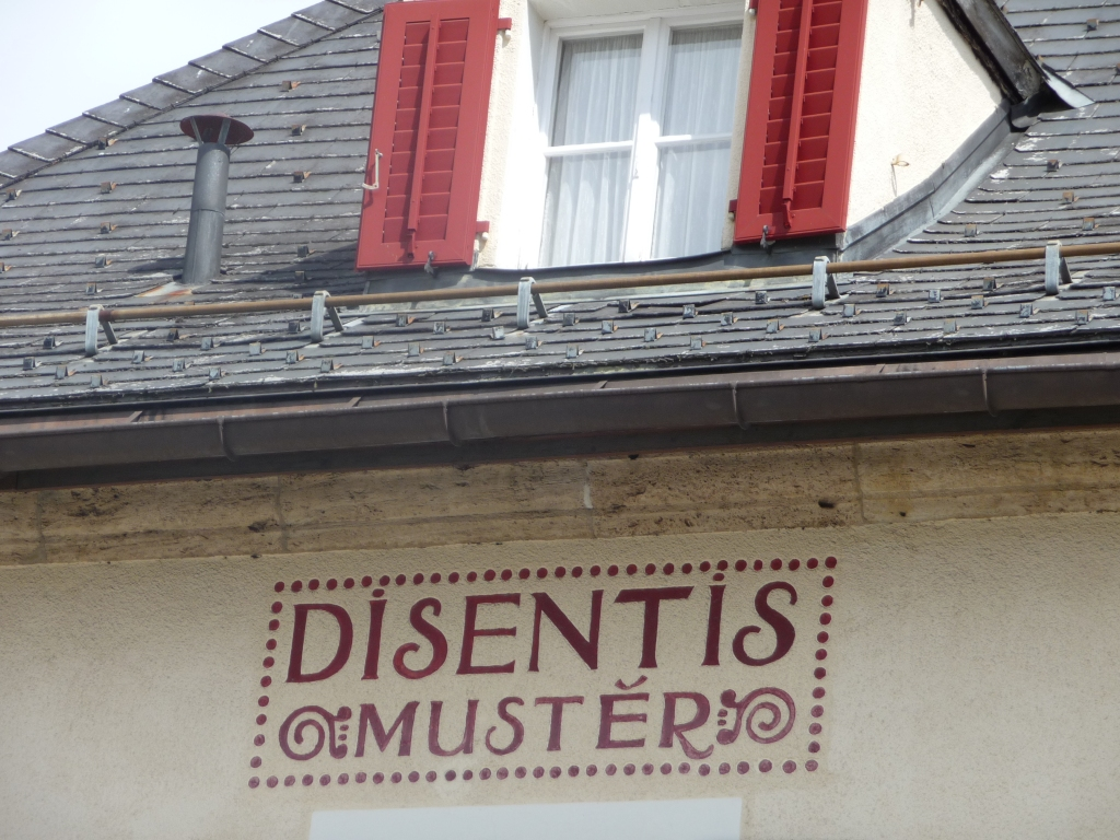 The charming railway sign in the little Swiss town of Disentis Muster in the heart of the Romansh speaking area of south east Switzerland