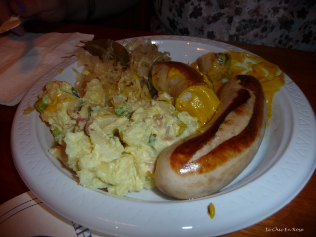 Traditional bratwurst with sauerkraut and potato salad