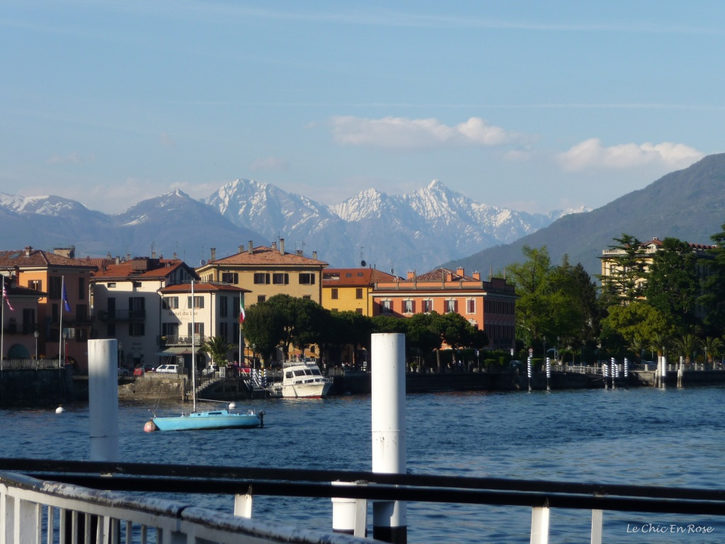 View boarding the boat at Menaggio Harbour looking back to the town with the Alps in the background