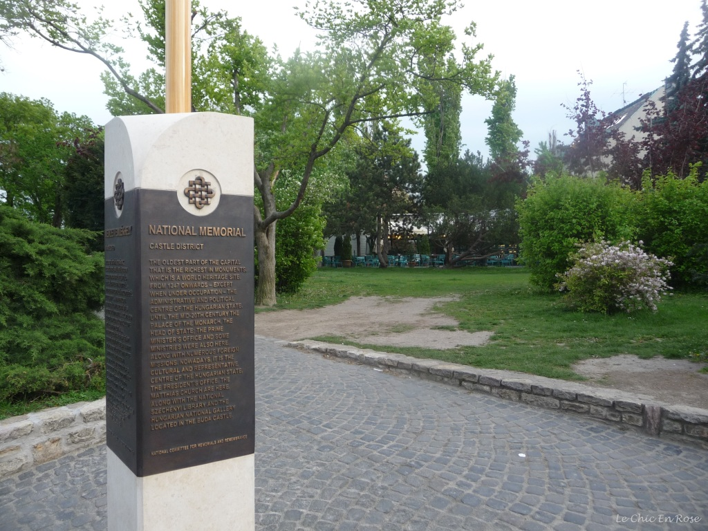 Obelisk in Buda Castle District displaying some of the area's history