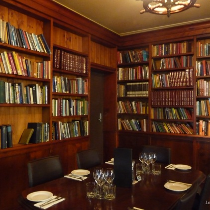 A well stocked library as you enter the restaurant