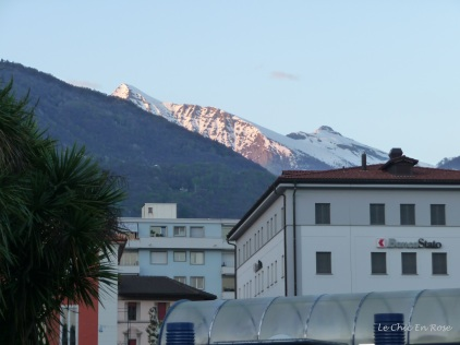 The Alps are not far away and mountains rise up behind the town centre