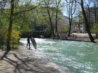 Surfer getting out of water on the Eisbach River