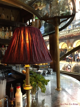 The beautiful burgundy lampshades in Cafe Boheme Soho