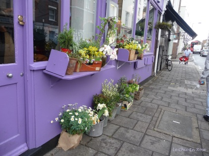 Rows of planter boxes adorn the front of the cafe