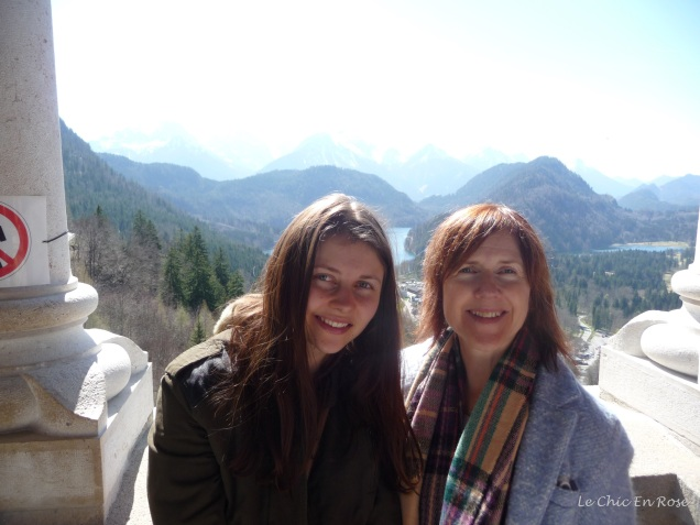 Mlle and Le Chic En Rose from the castle balcony with the Bavarian Alps in the background