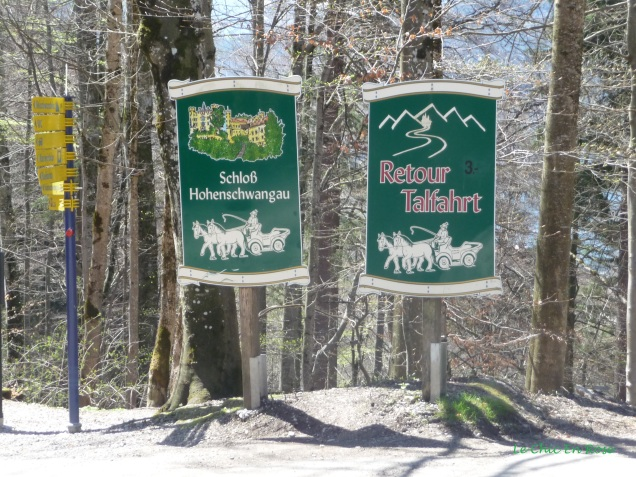 Signs for the horse and carriage ride