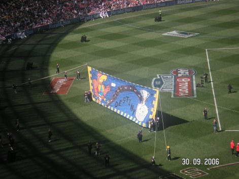 The footy banner that the players run through at the start of the game