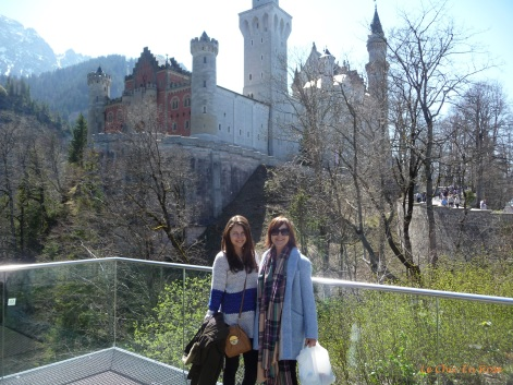 Mlle and Le Chic En Rose on the look out area over the Pollat Gorge with Neuschwanstein in the background