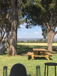 Outside tables at Oakover with a view towards the Perth Hills
