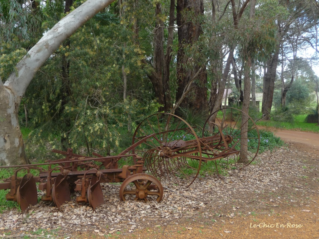 Old farm machinery dotted about the front of the property