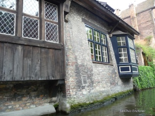 Old medieval building as seen from the canal