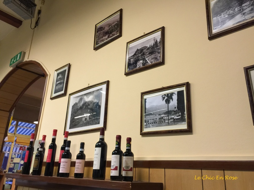 Old Framed Photos Of Menaggio Line the Wall