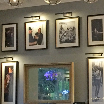 Framed photos of some of the cafe's famous guests