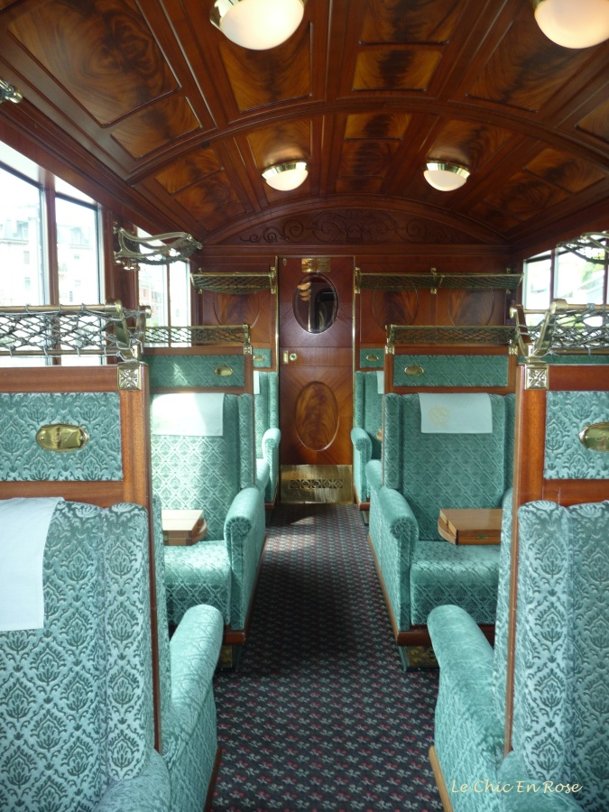 Plush green seats and wooden ceilings